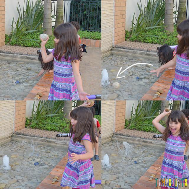 Como brincar com uma traquinagem de forma segura com as crianças - larissa jogando a pedra na agua