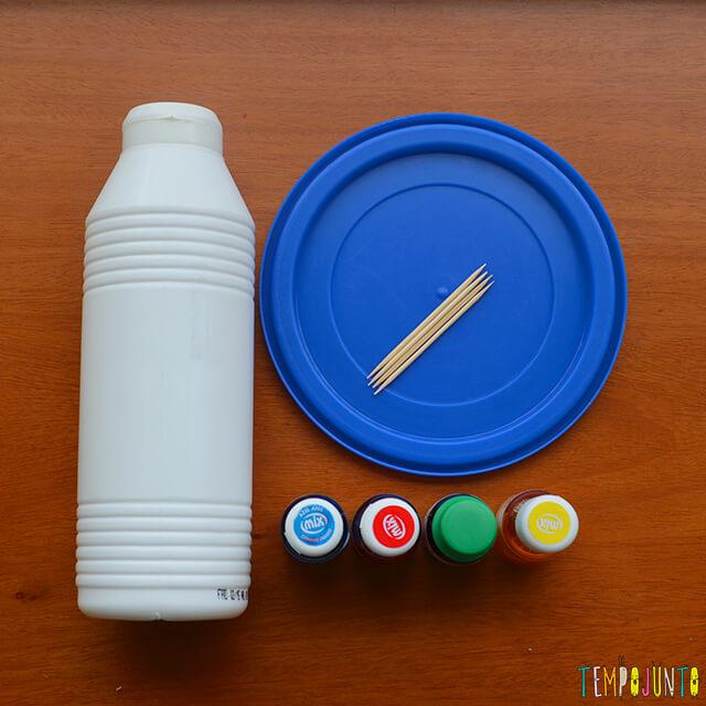 Um pintura com corante e cola para crianças - materiais