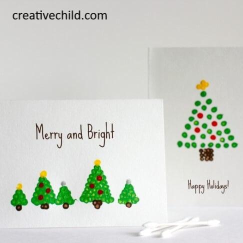 cartões de natal usando as mãos com pintura de cotonete